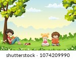 kids are sitting on a meadow... | Shutterstock .eps vector #1074209990