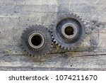 old gear wheels against wooden... | Shutterstock . vector #1074211670