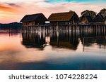 colorfull sunset at lake... | Shutterstock . vector #1074228224