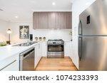 modern kitchen interior with... | Shutterstock . vector #1074233393