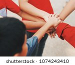 close up kids hands teamwork... | Shutterstock . vector #1074243410