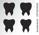 set of teeth. black silhouettes.... | Shutterstock .eps vector #1074244034