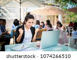 busy young business woman... | Shutterstock . vector #1074266510