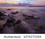 rock and wave in sunrise | Shutterstock . vector #1074272354