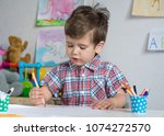preschool kid playing and... | Shutterstock . vector #1074272570