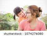 Portrait Of Happy Asian Mother...