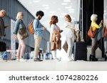 several passengers standing in... | Shutterstock . vector #1074280226