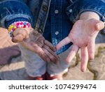 dirty and clean palm of little... | Shutterstock . vector #1074299474