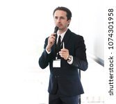 Small photo of Business speaker giving a presentation to audience