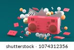 red radio amidst colorful balls ... | Shutterstock . vector #1074312356