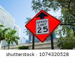 Small photo of Speed limit warning in miami, usa. Traffic sign on city road. Caution and warn concept. Transportation traffic and travel.