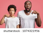 shocked father and son hold... | Shutterstock . vector #1074321956