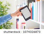 hands holding ebook on... | Shutterstock . vector #1074326873