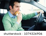hungry man starving and driving ... | Shutterstock . vector #1074326906