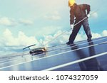 technician operating and... | Shutterstock . vector #1074327059