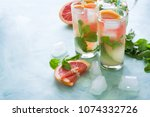 refreshment grapefruit cocktail ...   Shutterstock . vector #1074332726