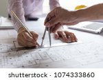 architect hands working on... | Shutterstock . vector #1074333860