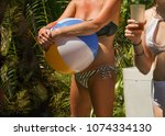 inflatable beach ball in hands... | Shutterstock . vector #1074334130