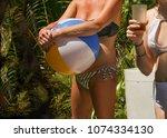 inflatable beach ball in hands...   Shutterstock . vector #1074334130