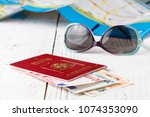 map  passport  notebook and cup ... | Shutterstock . vector #1074353090