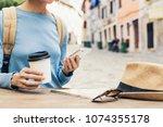 young traveller woman sitting... | Shutterstock . vector #1074355178