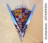 Small photo of Hamburg, Germany, April 2018 Cadillac. American Car Of The 1940s. Detail of the Model 62 Coupe Yoga Mat, 1947. Rarity ! Emblem, Hood ornament, Trademark, Logo, close-up