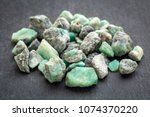 a pile of raw emerald gemstones ... | Shutterstock . vector #1074370220
