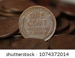 close up of us one cent coins... | Shutterstock . vector #1074372014