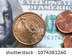 close up of us dollar bills and ... | Shutterstock . vector #1074381260