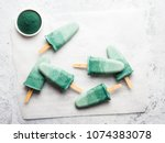 superfood spirulina popsicles.... | Shutterstock . vector #1074383078
