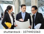 asia business man and woman... | Shutterstock . vector #1074401063