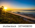 Sunrise over beach by Apalachicola, FL