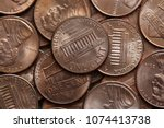 close up of us one cent coins... | Shutterstock . vector #1074413738