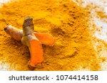 fresh root and turmeric powder  ... | Shutterstock . vector #1074414158