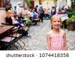 casual portrait of little girl... | Shutterstock . vector #1074418358
