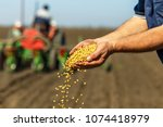close up of senior farmer with... | Shutterstock . vector #1074418979