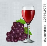 glass of red wine with grapes.... | Shutterstock .eps vector #1074419774