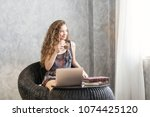 blonde female freelancer using... | Shutterstock . vector #1074425120