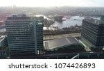 Small photo of Urban aerial photo Amsterdam city center business buildings showing two tall buildings located at Amsterdam docks in background showing further Amsterdam downtown and NEMO science museum