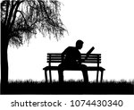 silhouette of a man with a book.   Shutterstock .eps vector #1074430340