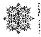 black isolated ethnic mandala...   Shutterstock .eps vector #1074445694