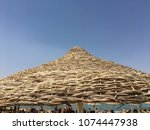 reed umbrellas beach on the...   Shutterstock . vector #1074447938