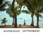 traveling boy sitting on the...   Shutterstock . vector #1074448640