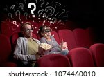 nice couple in cinema with... | Shutterstock . vector #1074460010