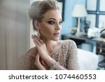 cheerful sexy lady getting... | Shutterstock . vector #1074460553