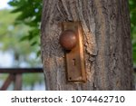 rusty old doorknob mounted to a ...   Shutterstock . vector #1074462710
