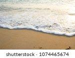 white waves on the beach...   Shutterstock . vector #1074465674