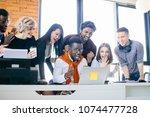 watching football match at work ... | Shutterstock . vector #1074477728