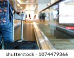 traveler with baggage take... | Shutterstock . vector #1074479366