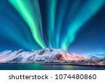 aurora borealis. lofoten... | Shutterstock . vector #1074480860